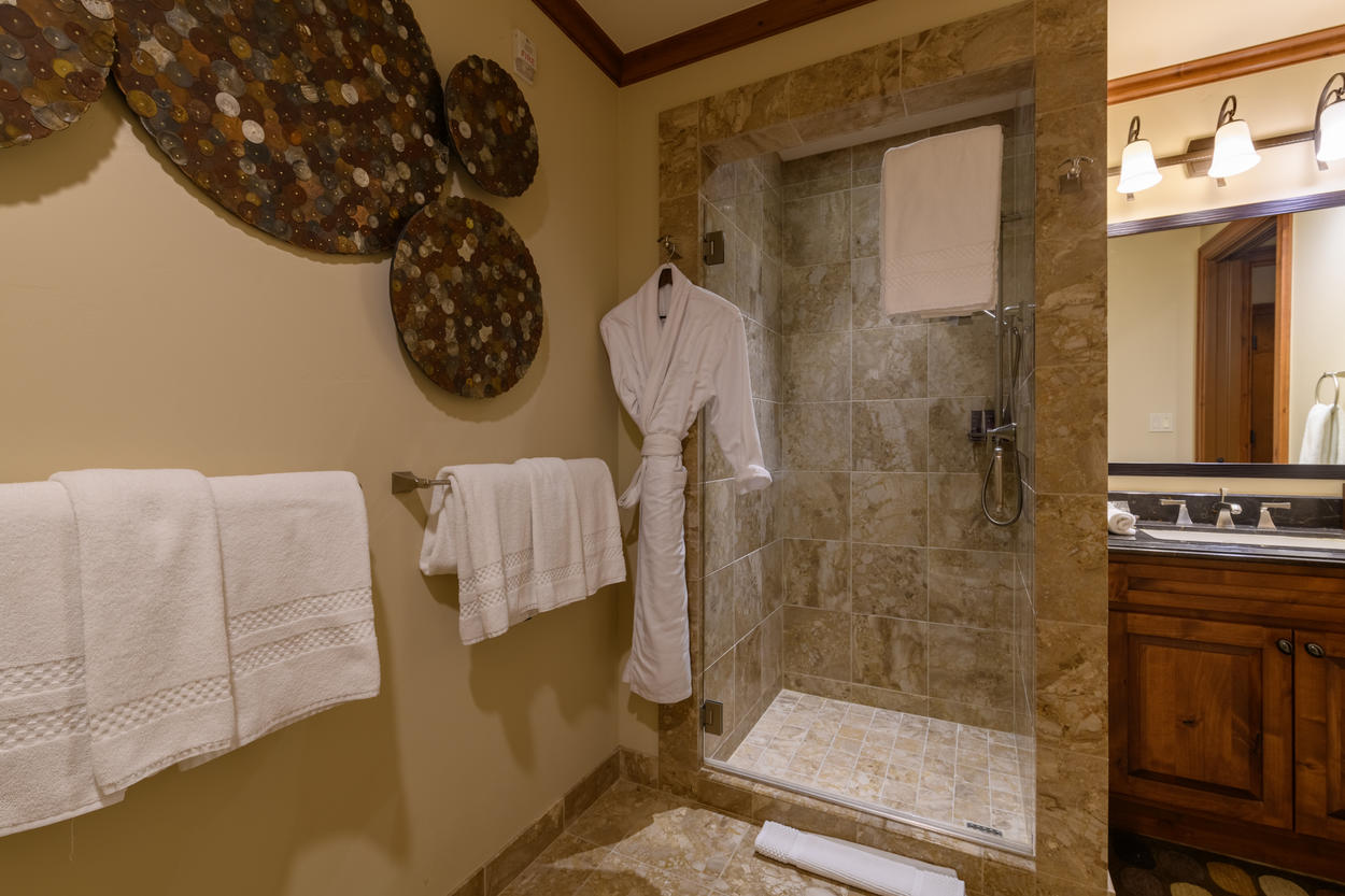 The shared full bathroom off the hallway has a walk-in shower and a single vanity.