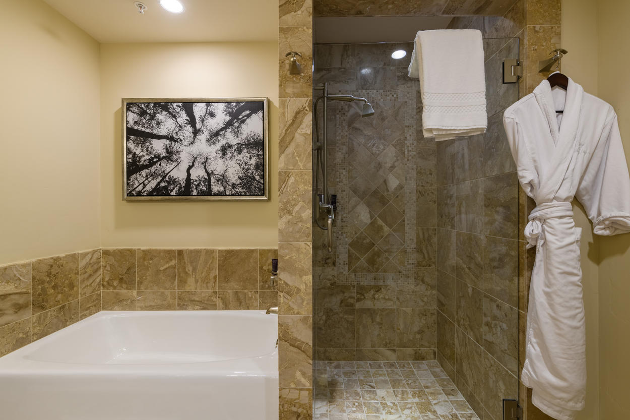 The Junior Master's ensuite has a soaking tub and a walk-in shower with sleek frameless door.