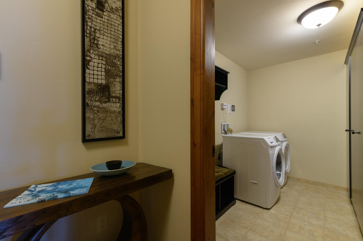 The home's storage room has a washer and dryer and offers additional space to store gear.
