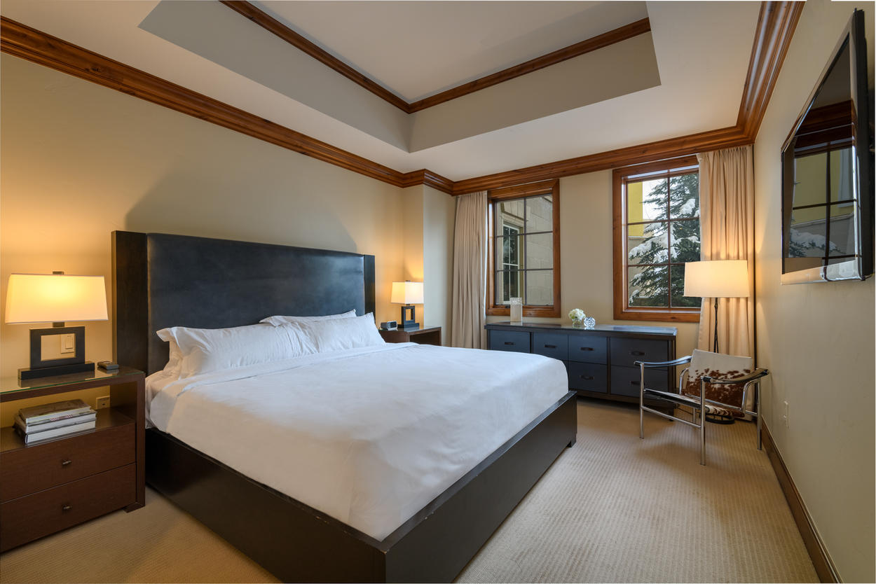 The Master Bedroom has a king bed and features a wall-mounted LED flat screen TV.