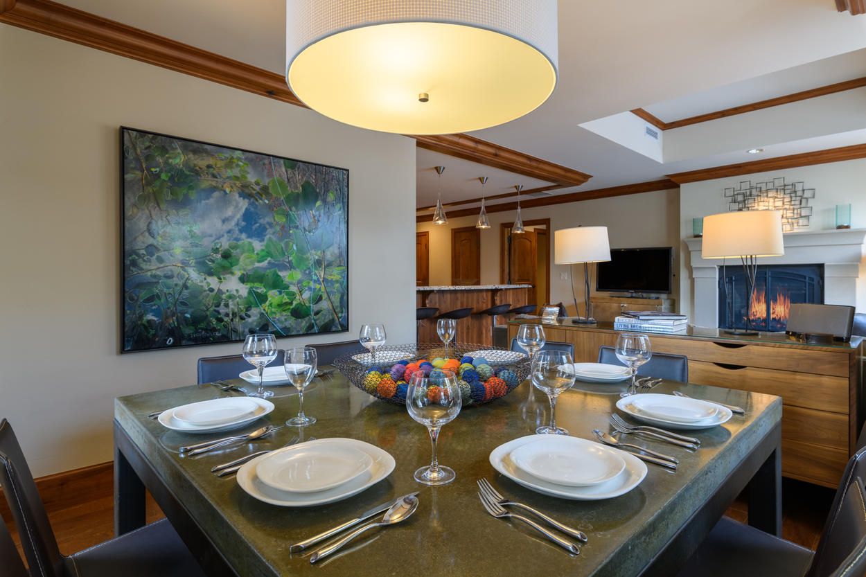 The formal dining table has seating for eight guests and offers beautiful original artwork.