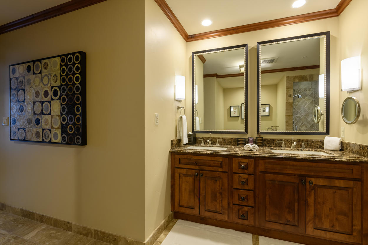 Pictured here is the double vanity in the Master Ensuite. Contemporary artwork like this piece can be found throughout the unit.