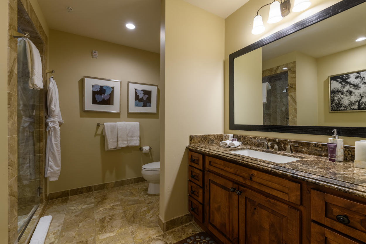 The spacious ensuite bathroom for the Junior Master has a single sink and large vanity.