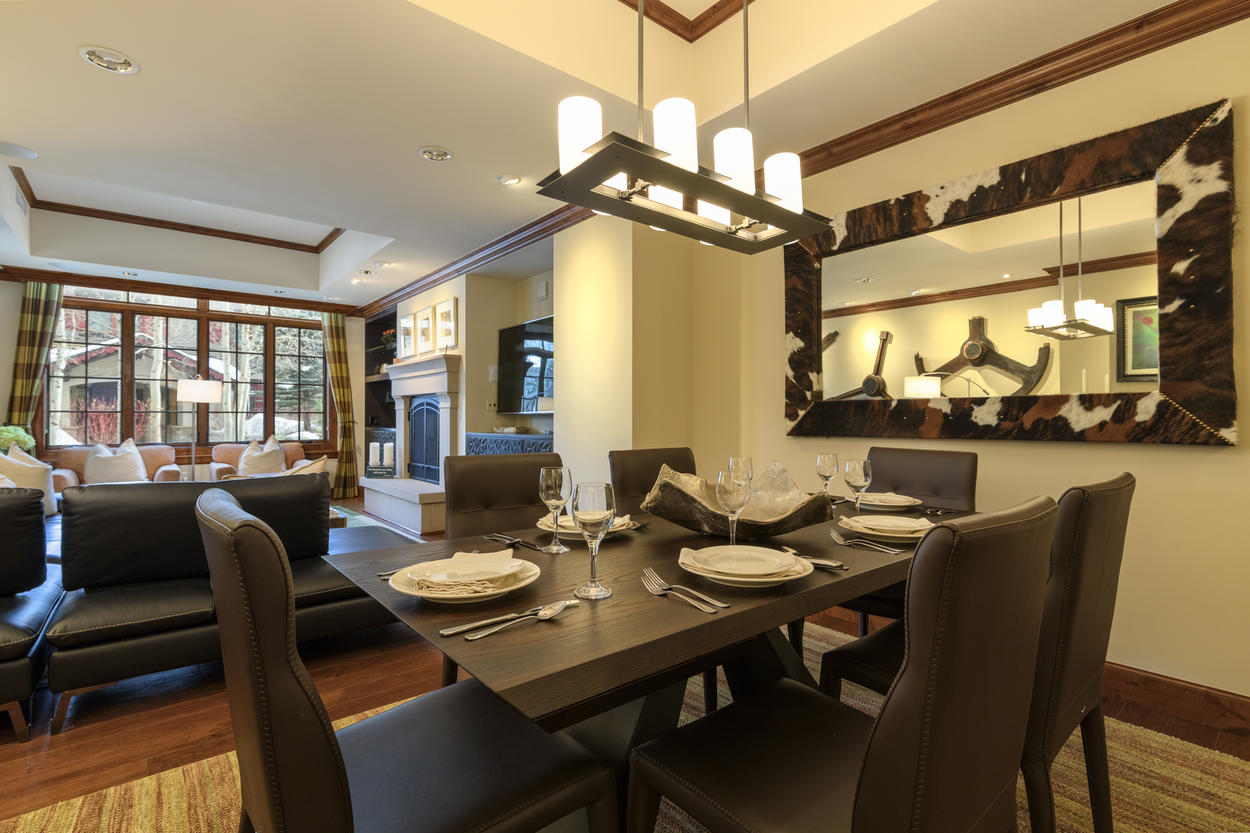 The formal dining table has seating for six guests.