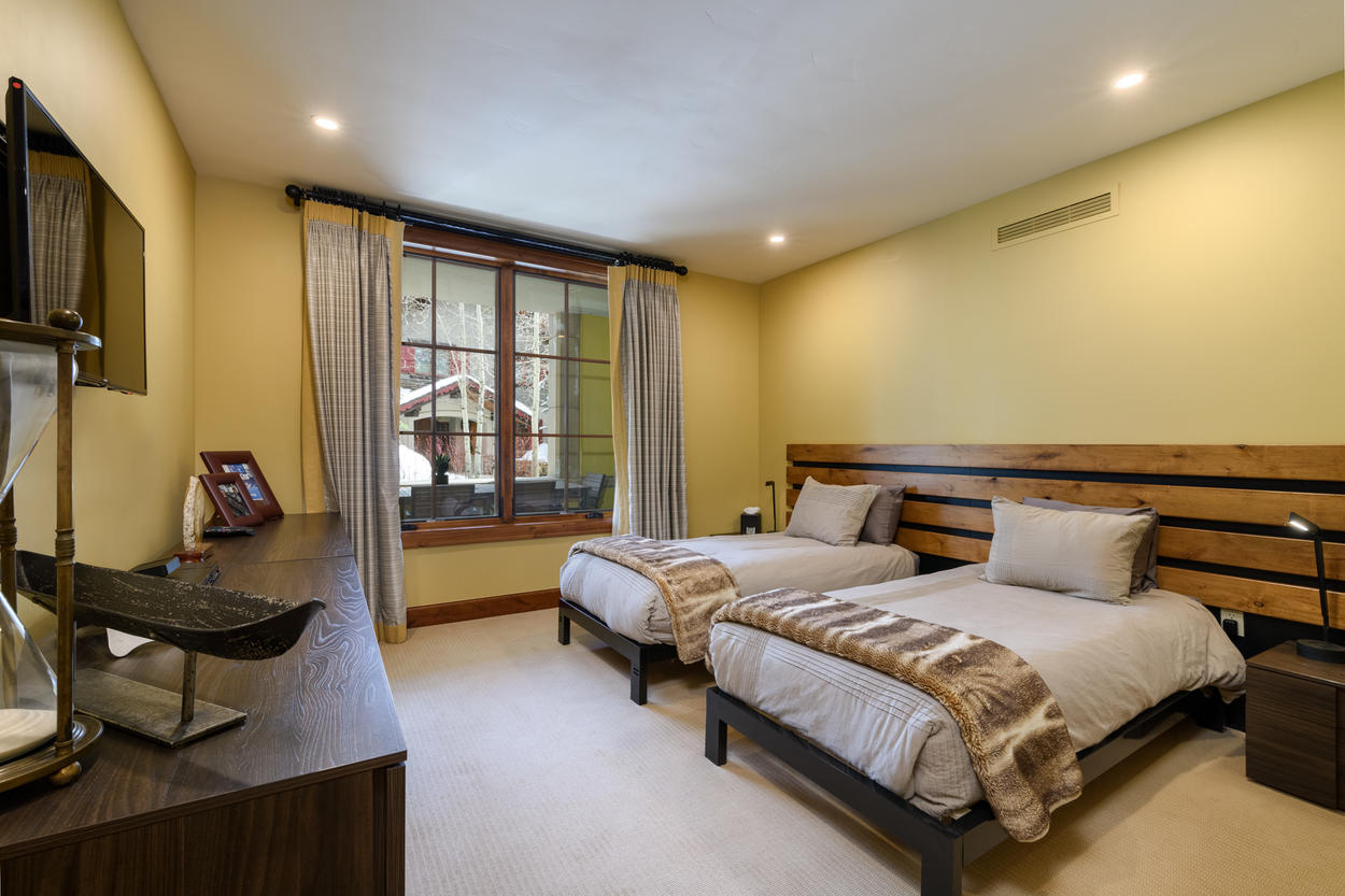 The guest bedroom has two twin beds, a TV, as well as its own ensuite bathroom.