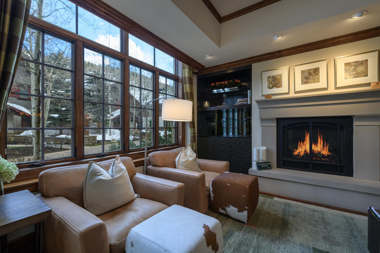 Large windows span the length of the wall in the living area.