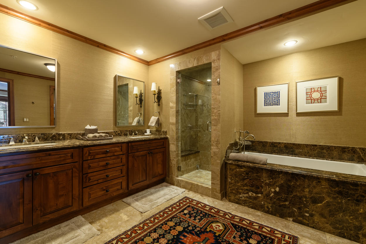 The Master Bath has a large double vanity, a walk-in shower, and a soaking tub.