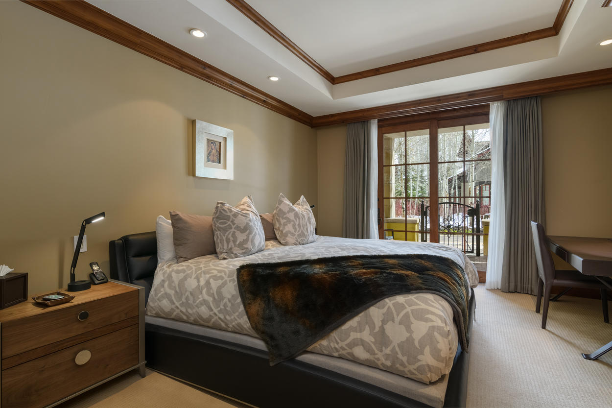 The Master Suite has a king bed and a TV, and access to the patio and walking path.