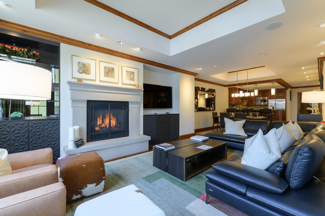 The main living area has a gas fireplace and plenty of seating and an open-living concept.