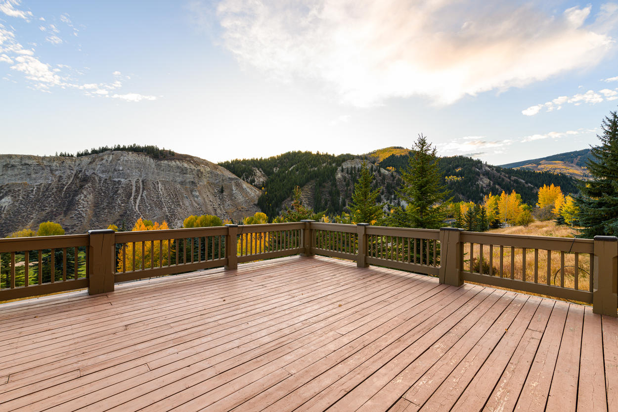 The large deck looks out over the Beaver Creek Golf Course and the large white bluffs that flank the valley.