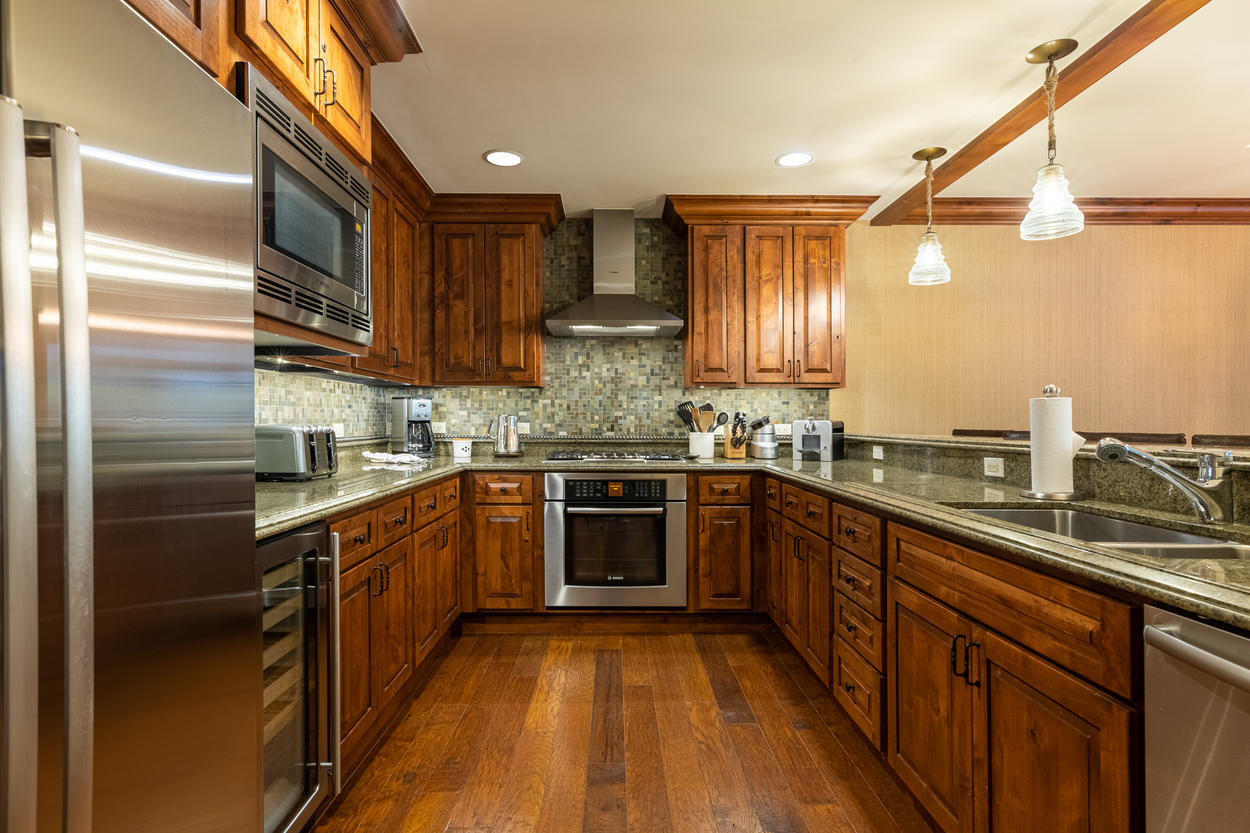 The galley-style kitchen has stainless steel appliances throughout.