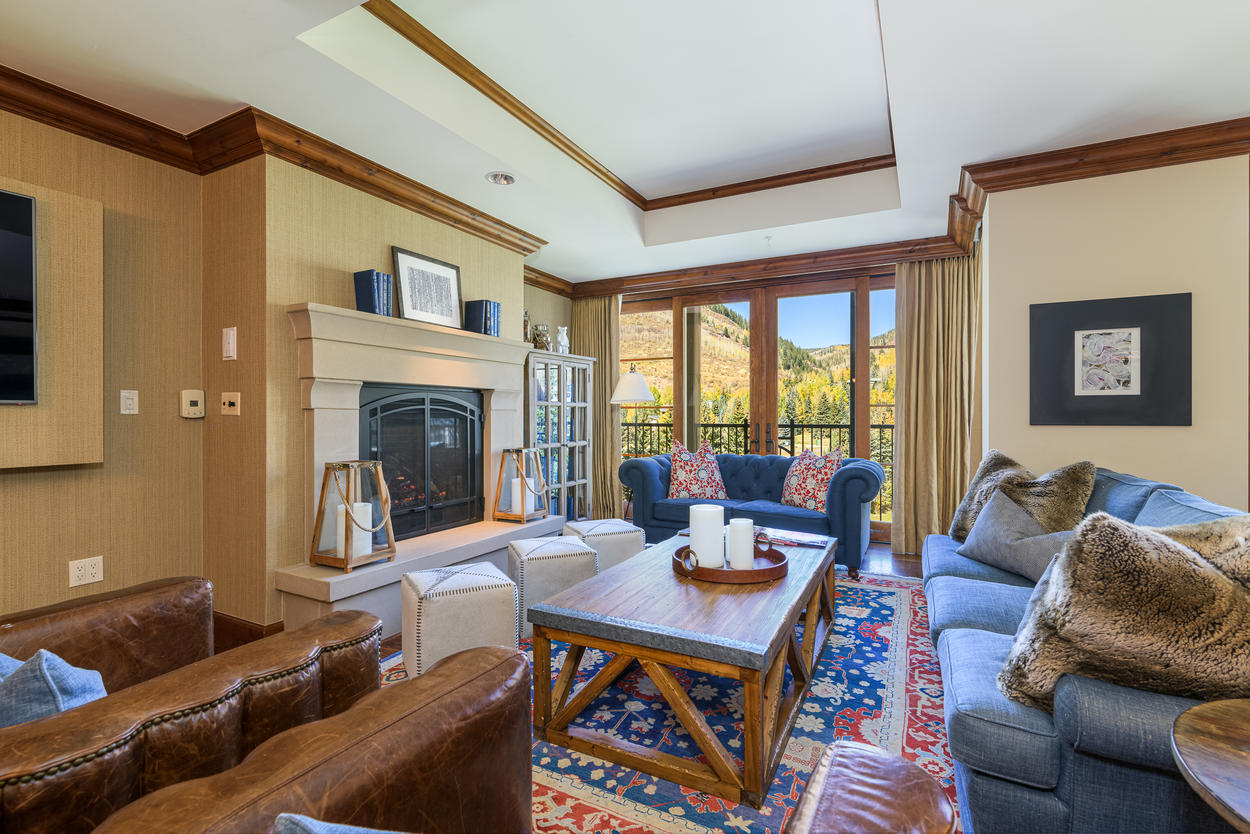 The stately gas fireplace acts as the centerpiece in the living room.