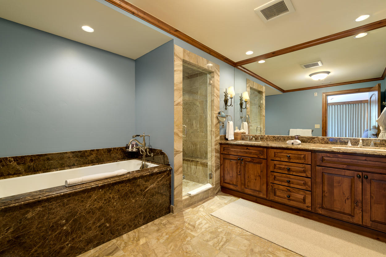 The Master Ensuite has a large double vanity and a luxurious soaking tub.