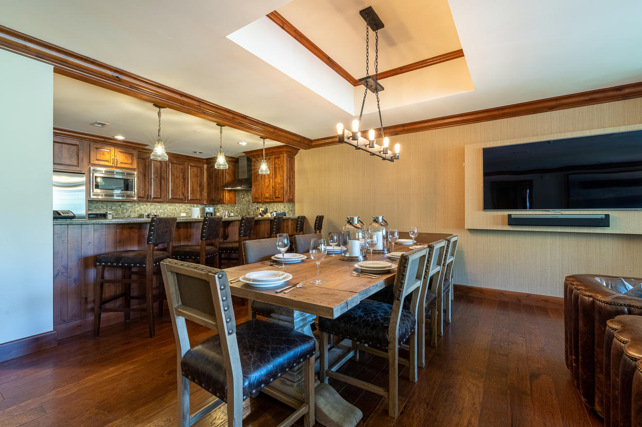 The dining table runs between the living area and the kitchen.