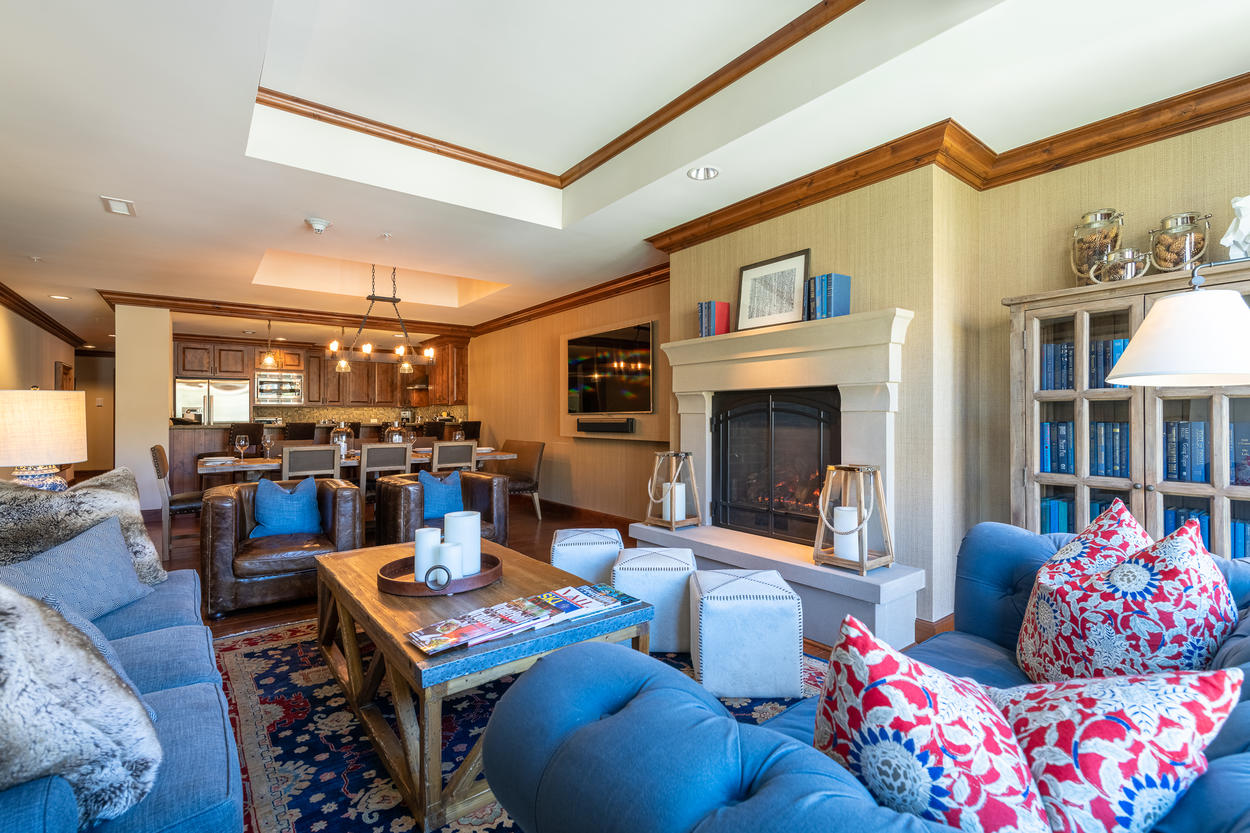 The main living room has two leather chairs and two sofas so all guests can relax in comfort.