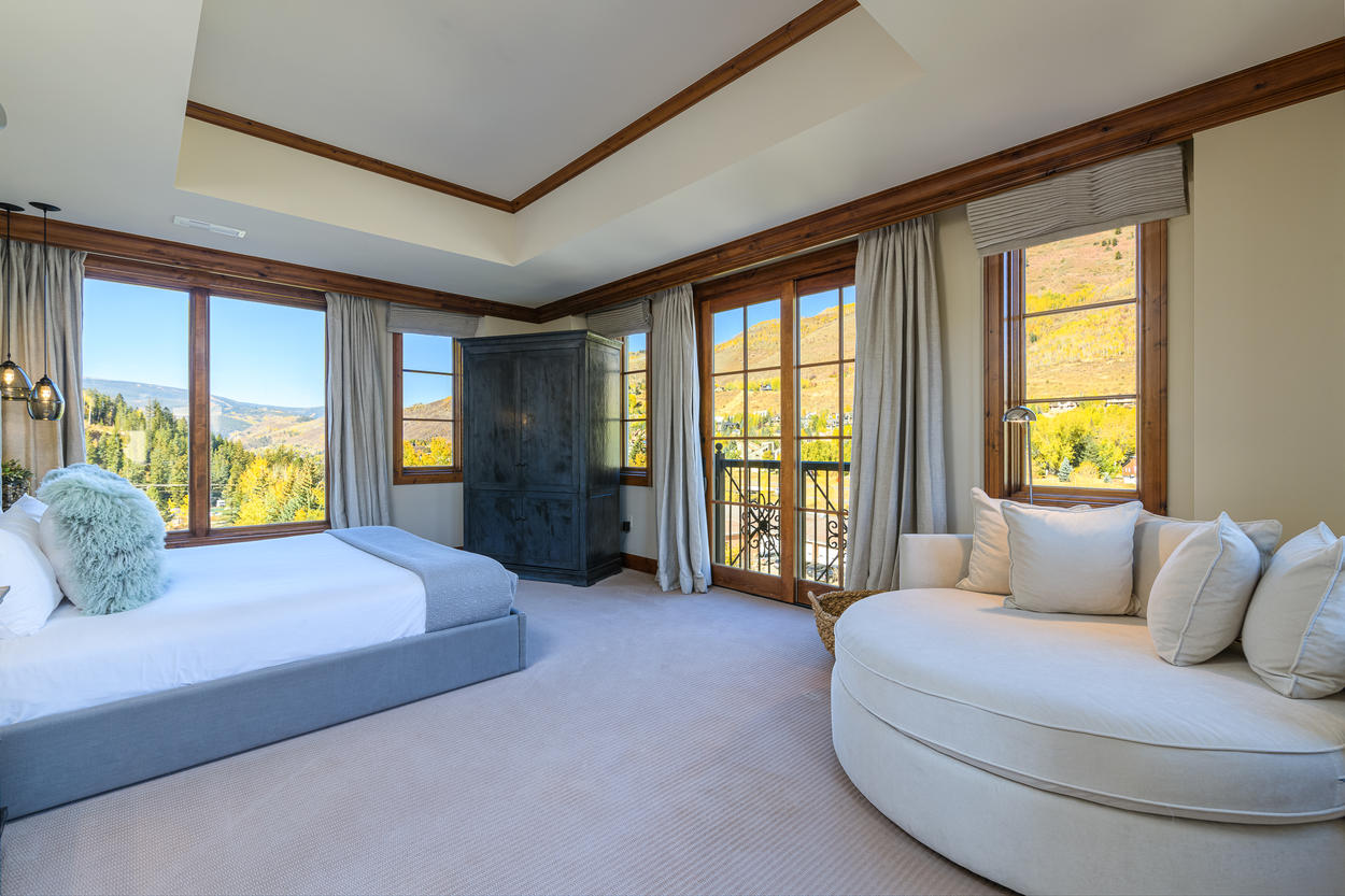 The Master Bedroom has a king-size bed, and corner views out both directions.