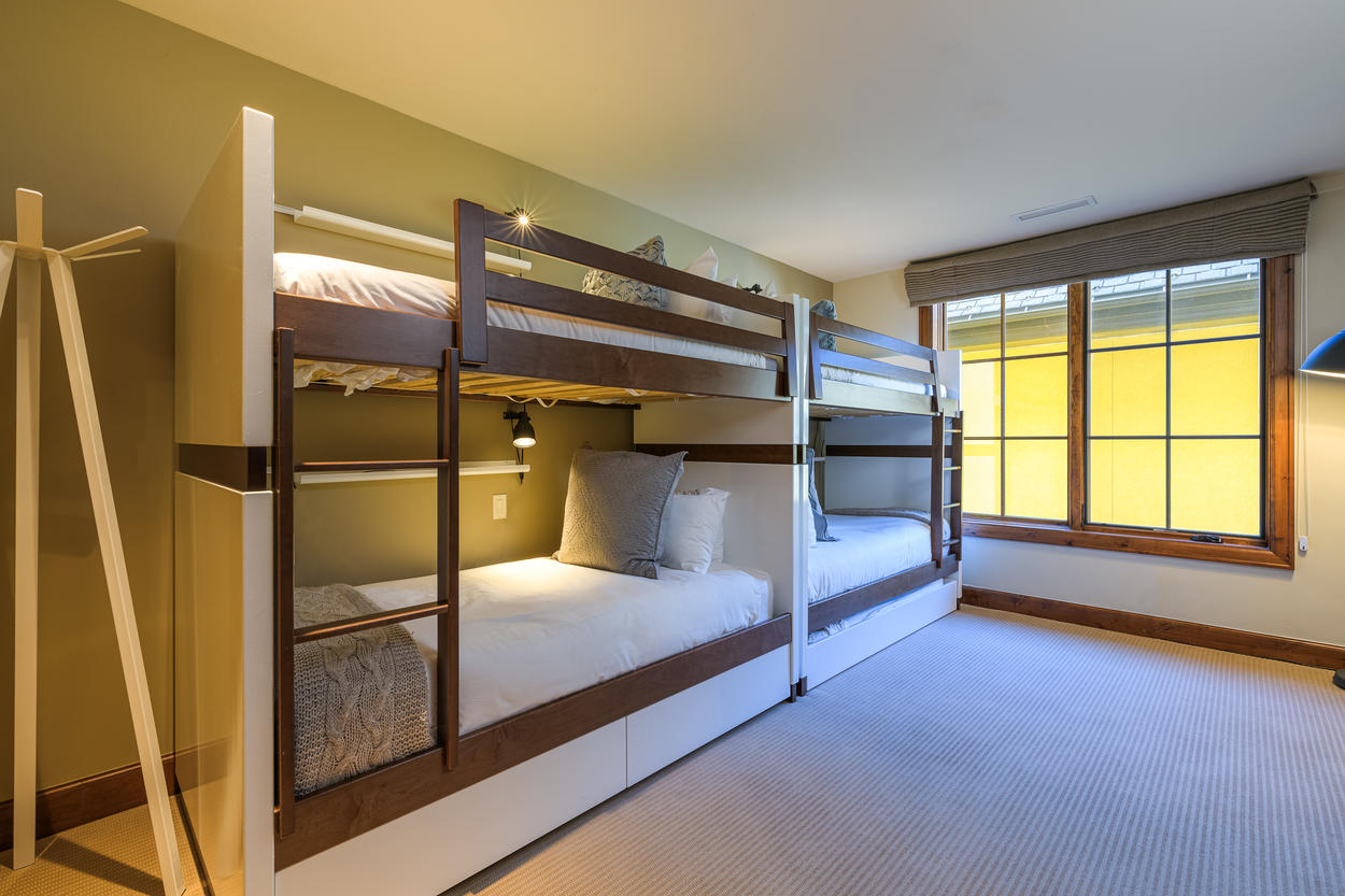 The Bunk Room can accommodate 5 guests in 2 twin bunk setups and a trundle bed.
