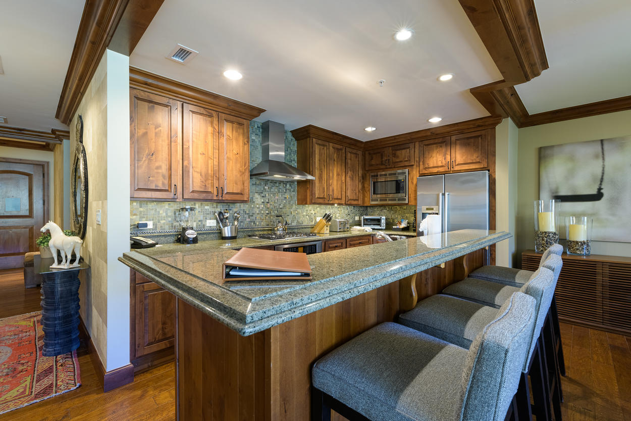 The kitchen breakfast bar has seating for 4 guests.
