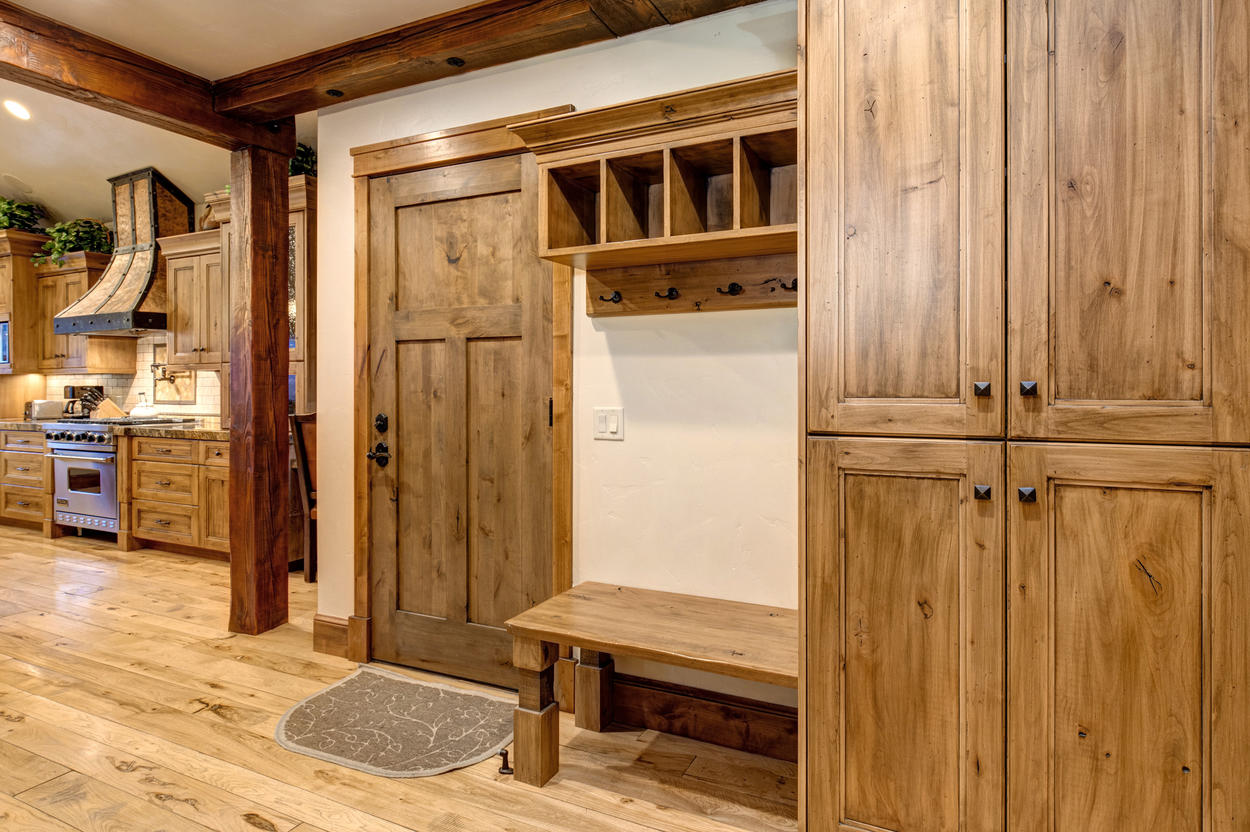 Convenient coat racks and cubbies are set right next to the entryway.