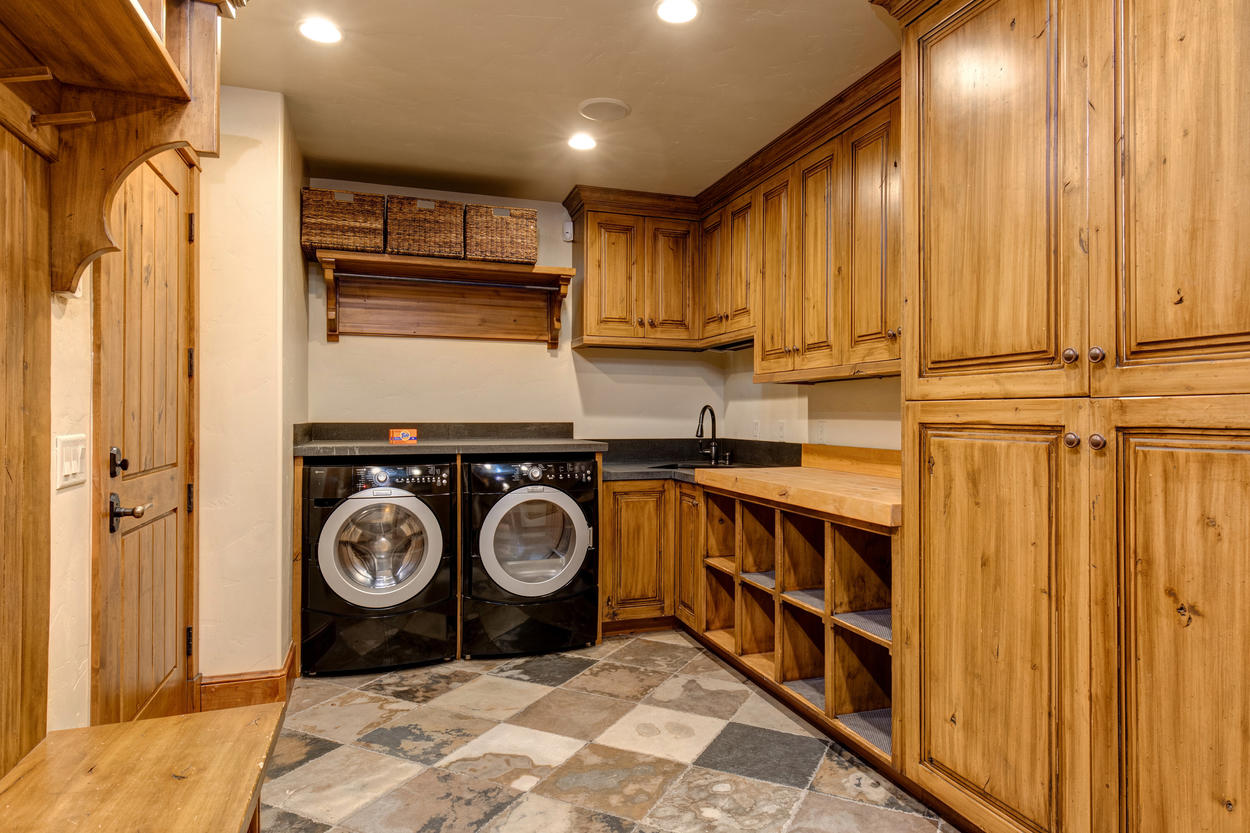 A large ski storage area also serves as a mud room and laundry room to keep you and the home spotless.