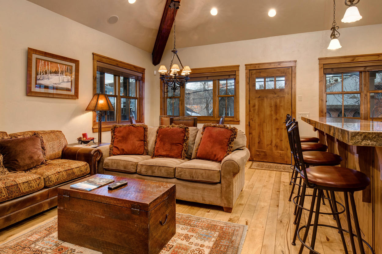 The main living area is adjacent to the breakfast bar and kitchen, perfect for evenings in with the family.