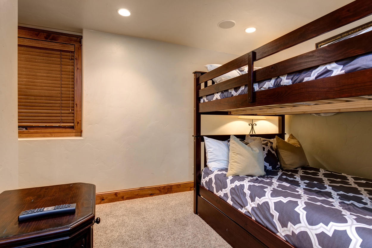 Another set of bunks in the bunk room has two twin beds.
