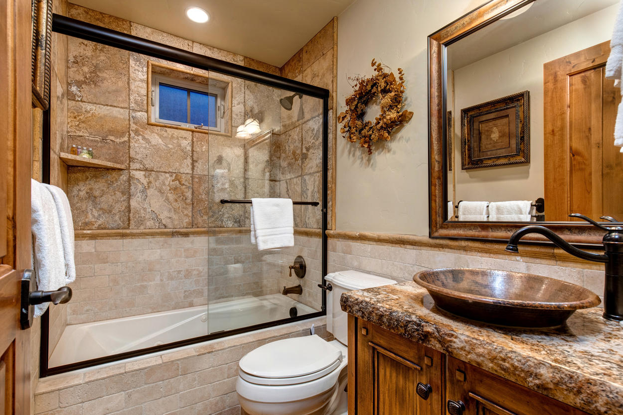 The guest bathroom on the main floor has a magnificent  combination shower/tub made of a mix of brickwork and tile.
