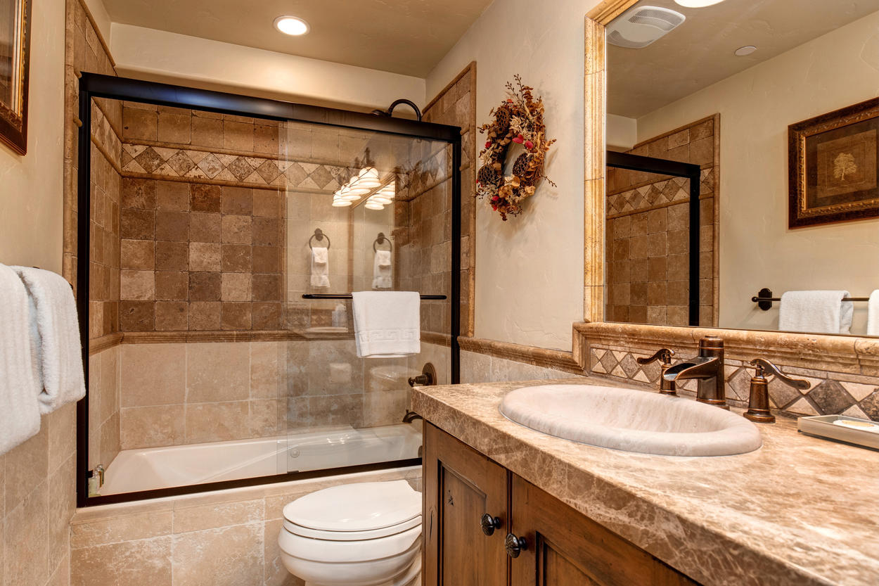 The bunk room ensuite has a combination tub/shower and an immaculate white granite sink.
