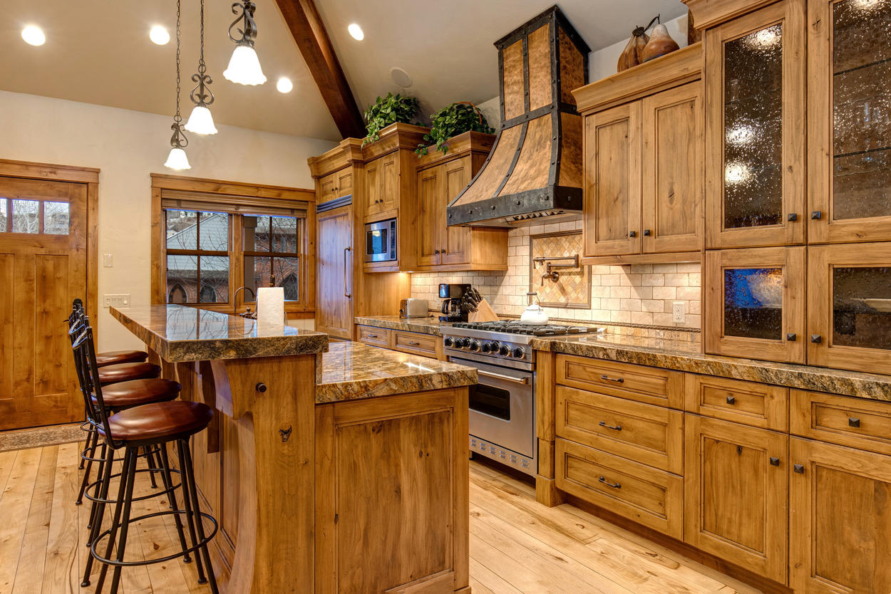 Every inch of the kitchen was crafted with detail, from the refrigerator to floors and range hood.