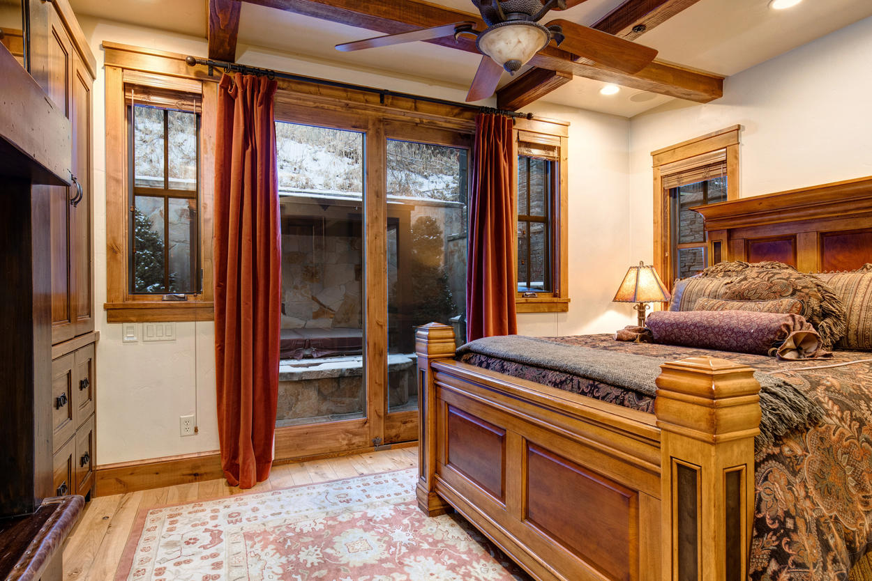 The queen guest bedroom has direct access to the back patio and hot tub.