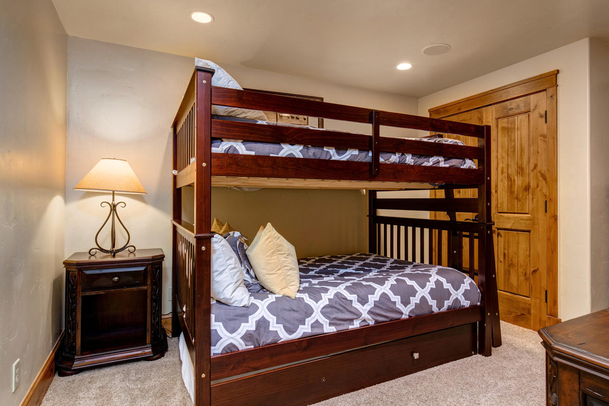 The bunk room has a bunk with two full beds, as well as a twin trundle.