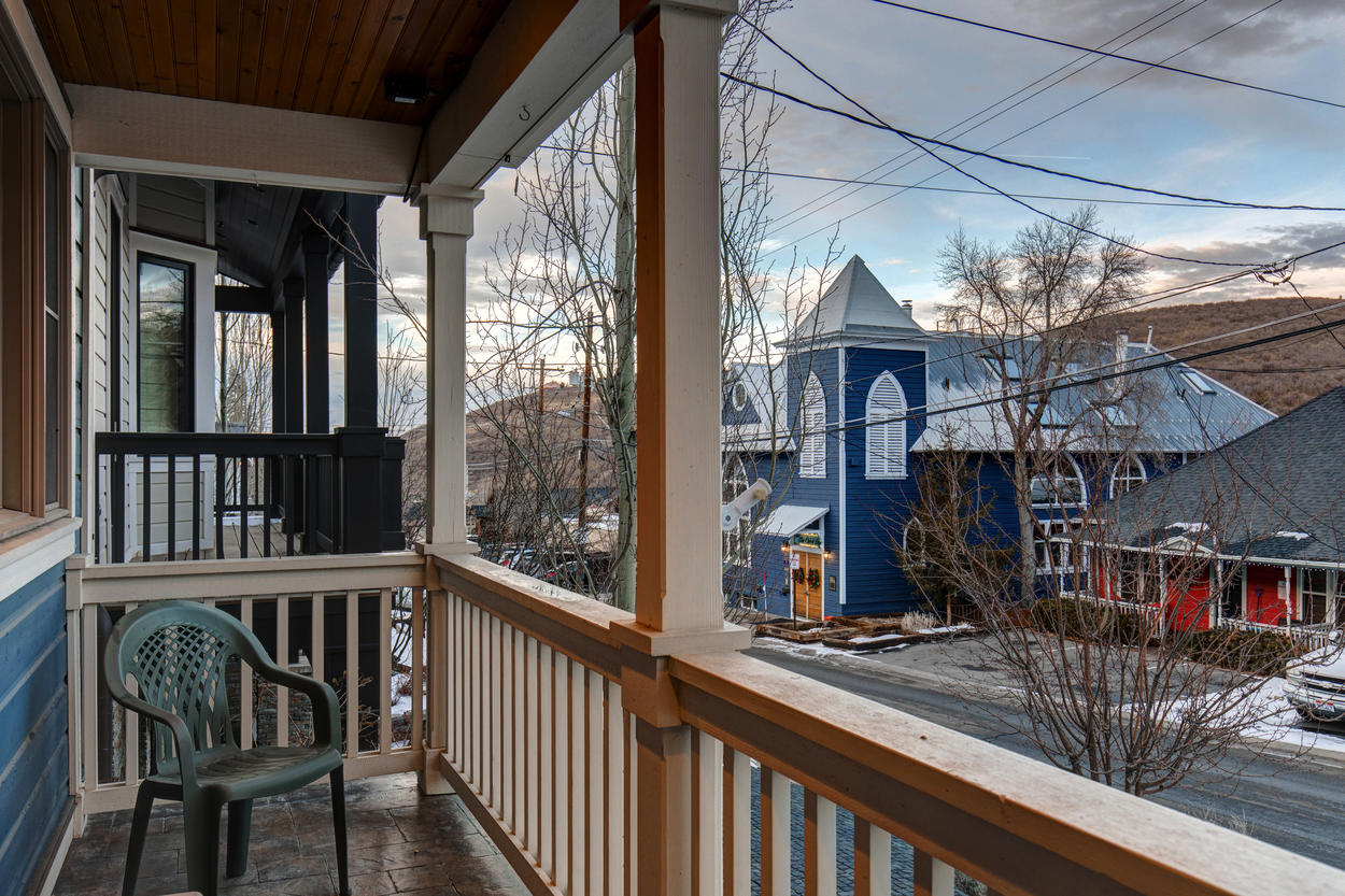 Relax in the outdoor seating on the front porch.