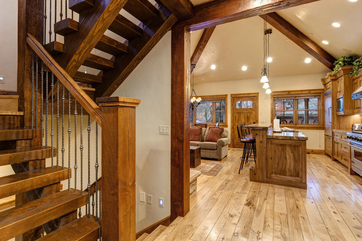 From the main floor, take the stairs up to the Master Bedroom or down to the bunk room.