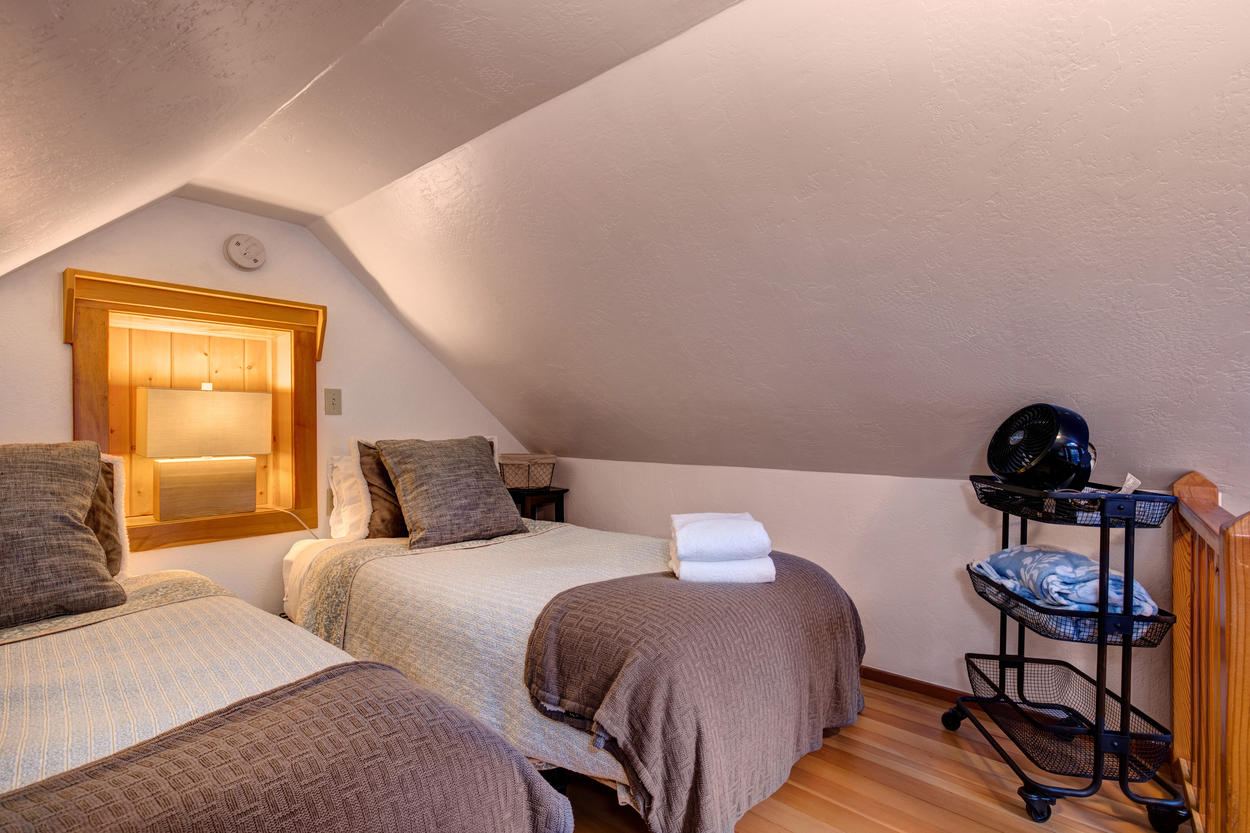 Just up the staircase, you'll find two twin beds in the loft room.
