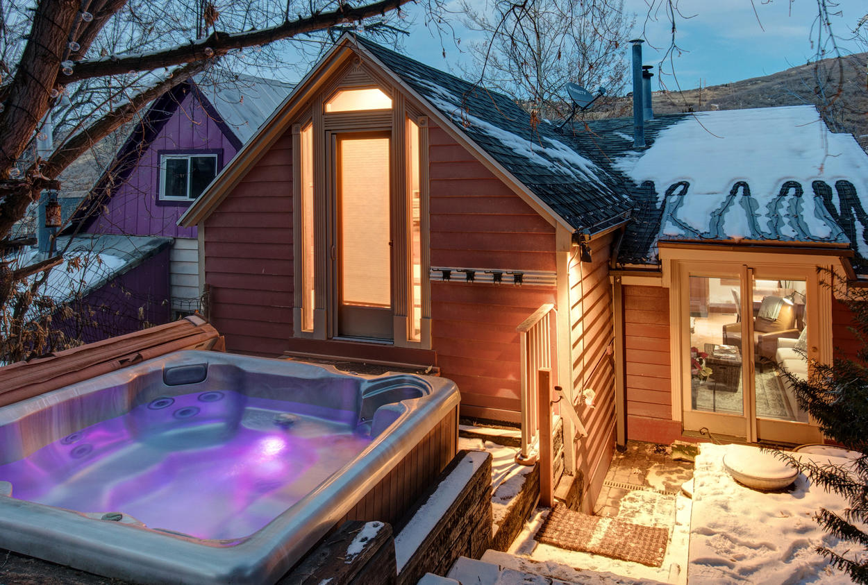 A private hot tub sits high up in the terraced backyard.