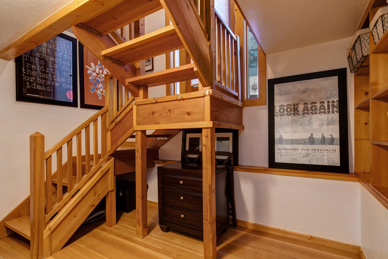 A timeless wood staircase transports you from the living area to the upstairs loft.