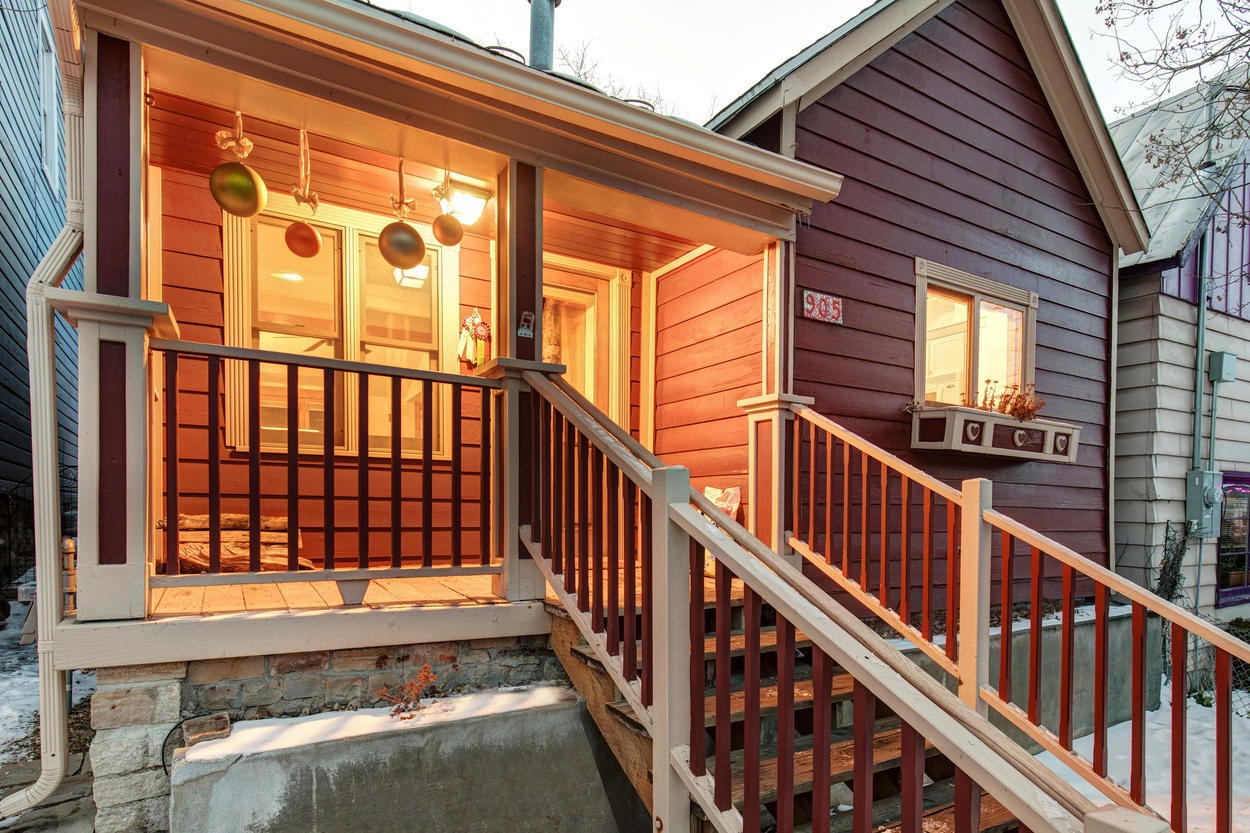 The wooden porch of this cozy home is exactly what you'd expect from Old Town Park City.