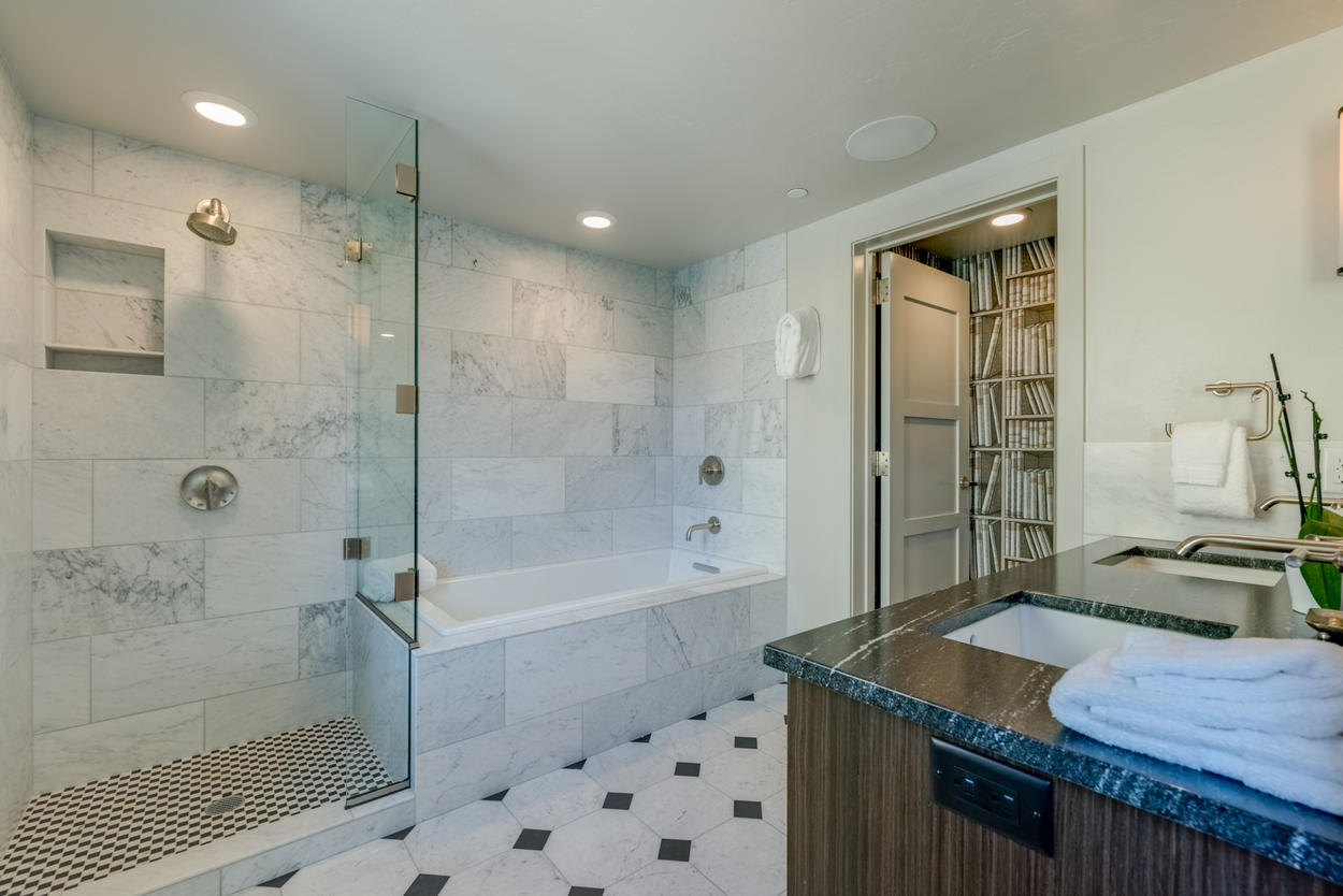 Have a soak in the Master Ensuite's tub, or step onto the checkered floor of the stand-alone shower