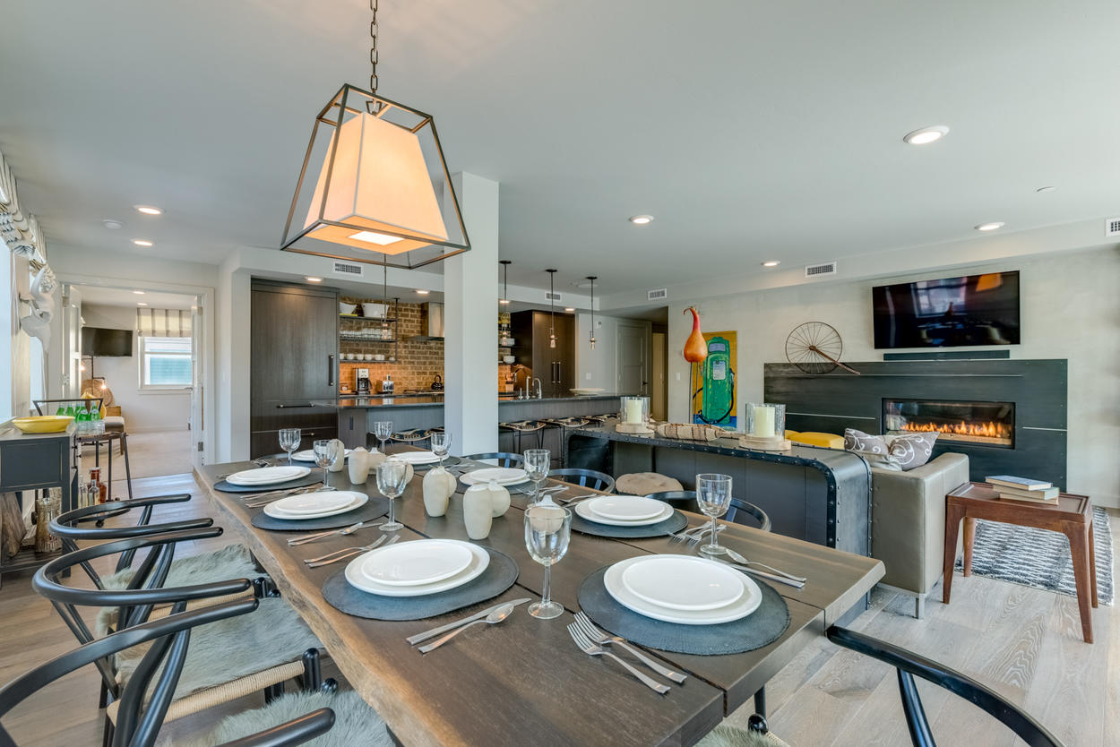 Dine with up to 7 of your friends at the wooden dining table in this open-concept living space