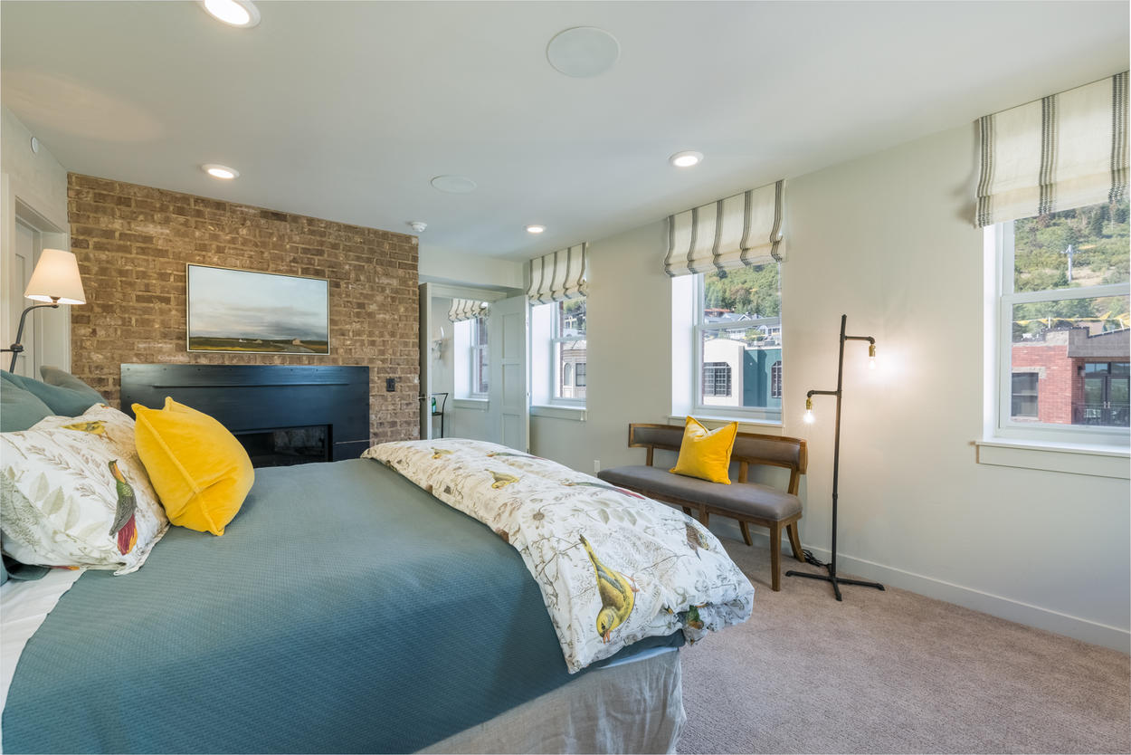 The Master Bedroom features a king bed and several vantage points for looking out over town