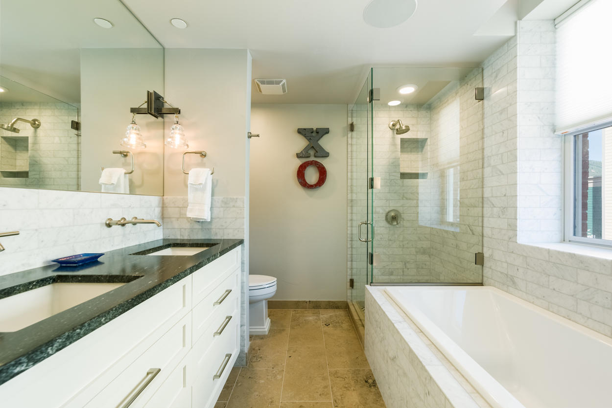 A soaking tub and shower await in Guest Bathroom 2