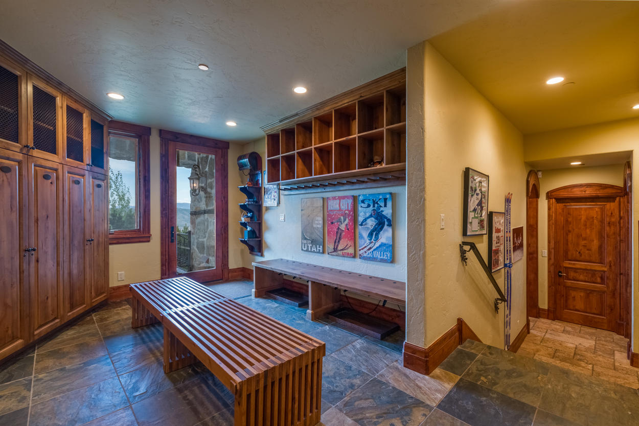 The main level mud room has plenty of room for skis, clubs, and any extra gear you bring along