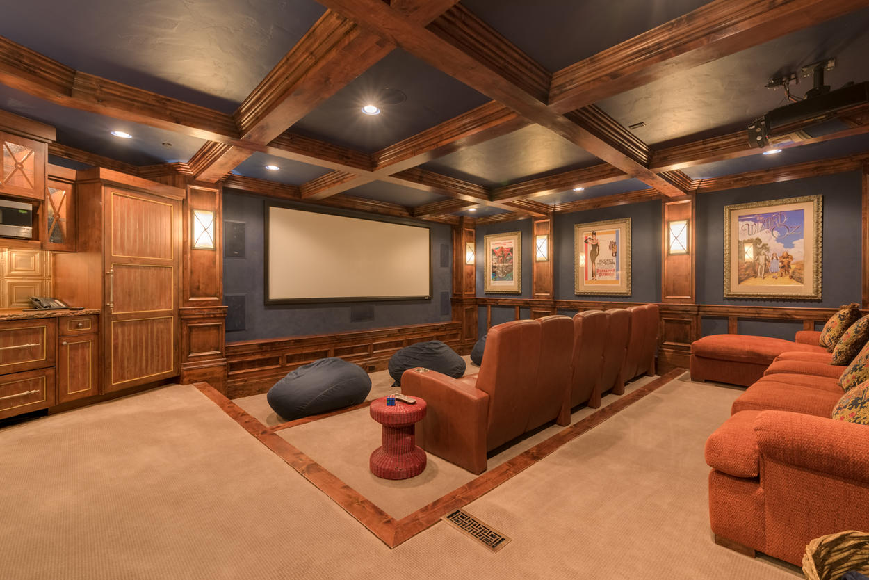 Your home theater offers plentiful plush seating and a premium projection system
