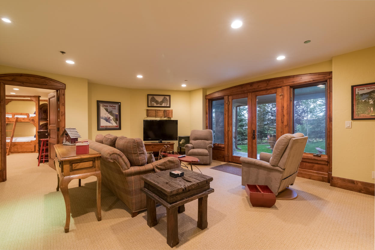 The lower-level media room is perfect for enjoying a little tv with extra privacy, or stepping out onto the lawn