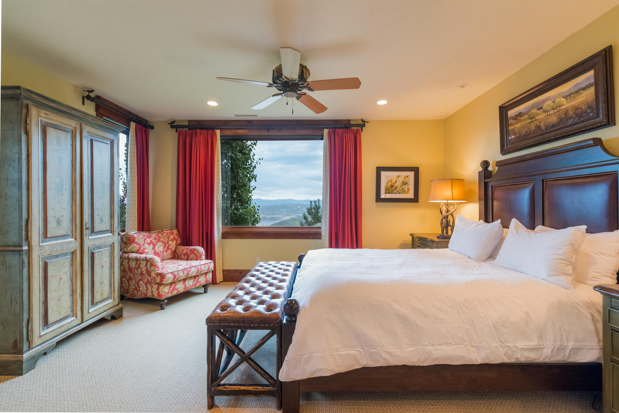 The junior master suite on the second level holds a full-sized bed and offers patio access