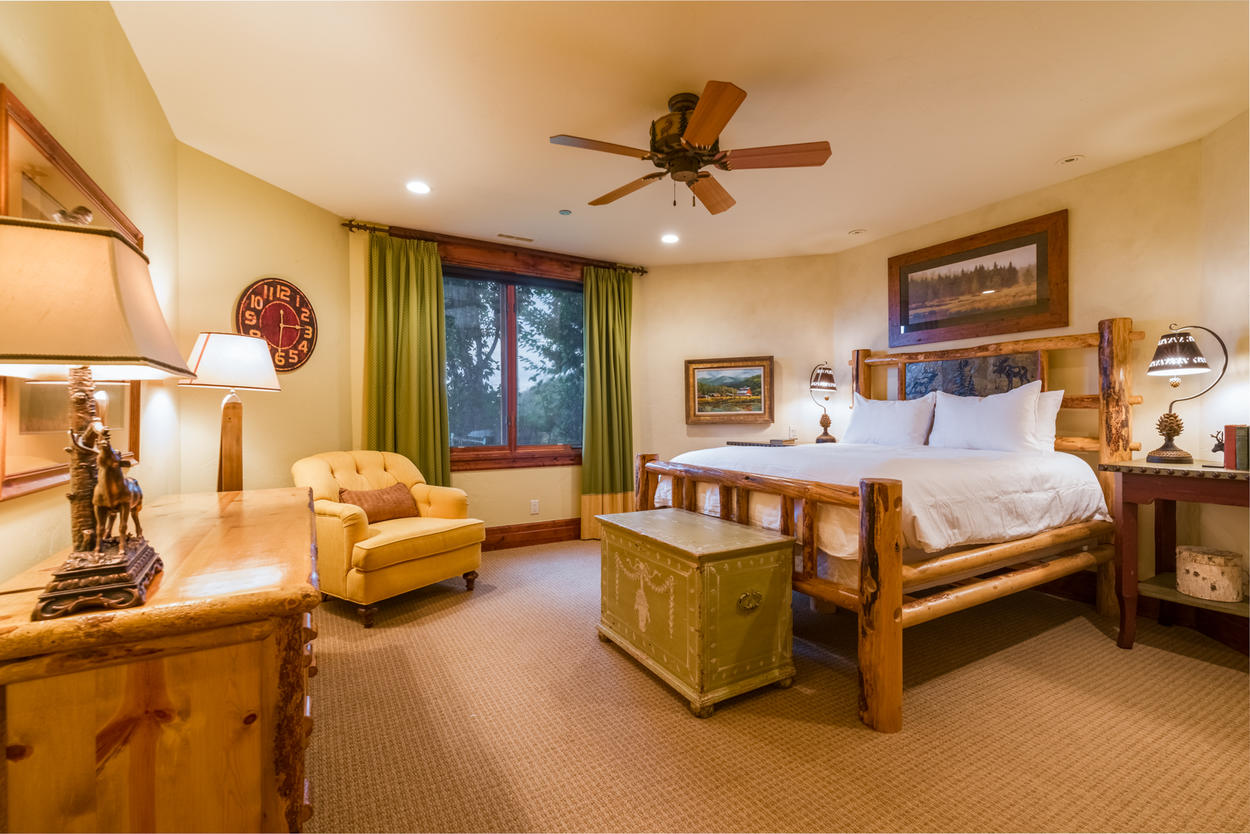 Still on level two, another queen master suite features a queen bed and tons of space