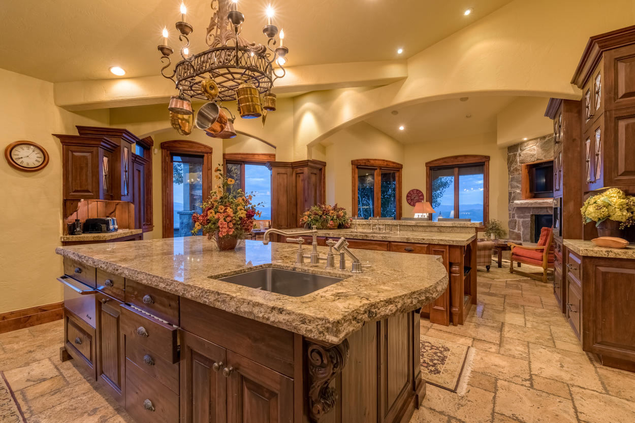 The open concept and additional seating areas just off the kitchen ensure the fun never stops