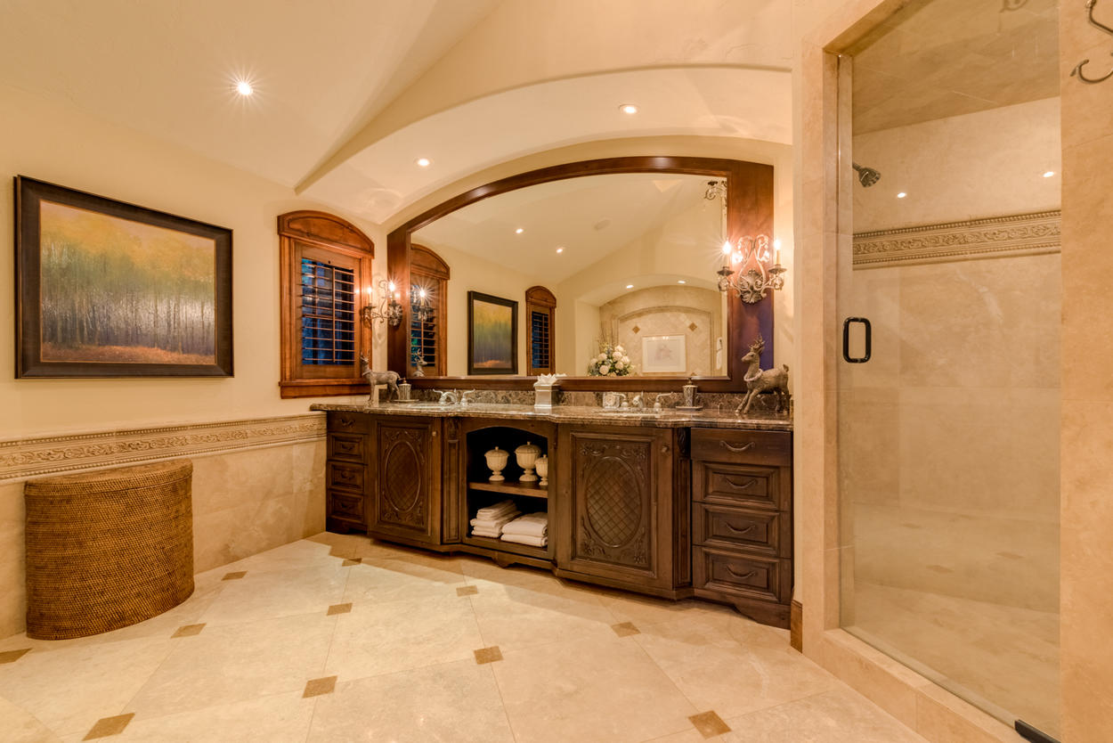 The spacious Master ensuite offers a walk-in steam shower and granite-topped dual vanity
