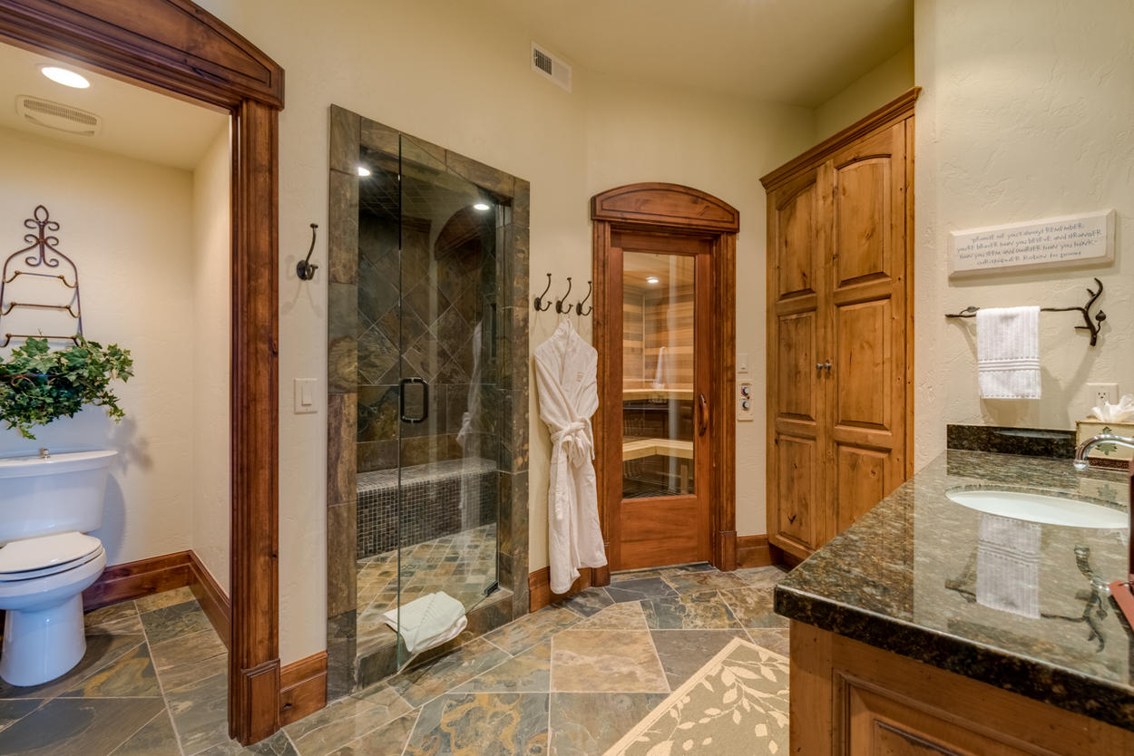 The adjacent bathroom to Guest Bedroom 5 hosts a shower plus the luxurious sauna
