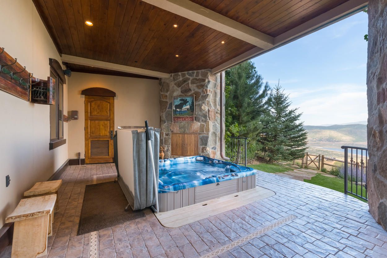 On the second level you'll find the private hot tub protected from the elements